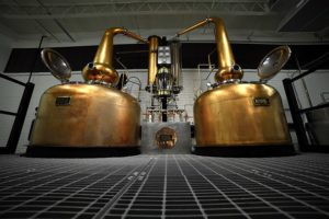 Blending in: Craft whiskey makers tap the big guys